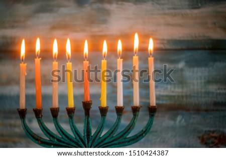 Jewish holiday, Holiday symbol Hanukkah Brightly Glowing Hanukkah Menorah soft focus #1510424387