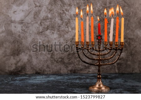Jewish holiday, Holiday symbol Hanukkah Brightly Glowing Hanukkah Menorah soft focus #1523799827
