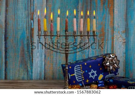 Jewish holiday, Holiday symbol Hanukkah Brightly Glowing Hanukkah Menorah soft focus #1567883062