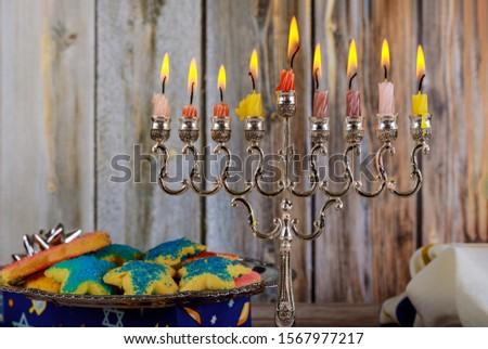 Jewish holiday, Holiday symbol Hanukkah Brightly Glowing Hanukkah Menorah soft focus #1567977217