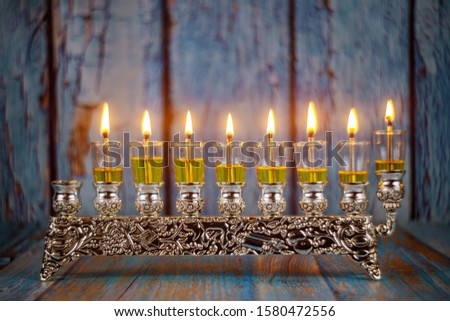 Jewish holiday, Holiday symbol Hanukkah Brightly Glowing Hanukkah Menorah soft focus Stok fotoğraf ©