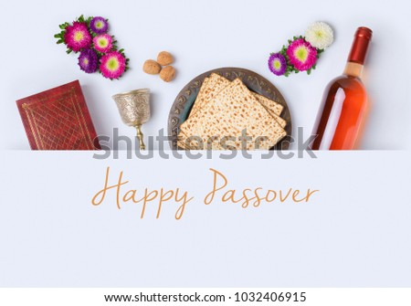 Jewish holiday Passover banner design with wine, matzo and seder plate on white background. View from above. Flat lay #1032406915