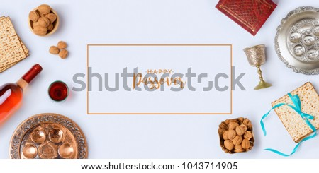 Jewish holiday Passover banner design with wine, matzo and seder plate on white background. View from above. Flat lay.Hebrew Text: Passover, horseradish, celery, egg, bone, bitter herb, fruit paste