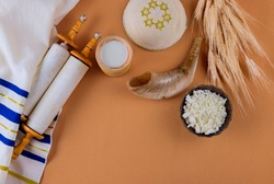 Jewish holiday Shavuot for kosher set dairy food on torah scroll and tallis