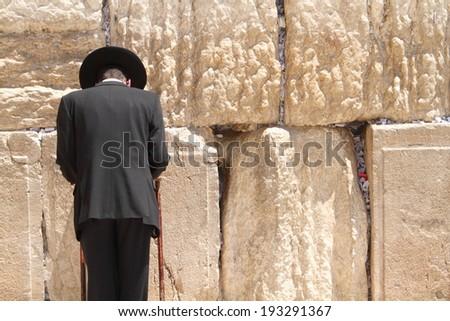 Jewish man at the wailing wall jerusalem prayer - stock photo