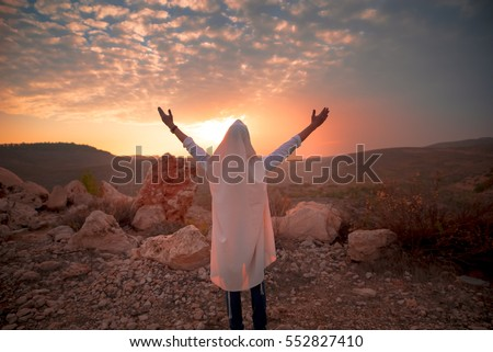 Jewish men prayer With Talit and tefillin in sunset Stockfoto ©