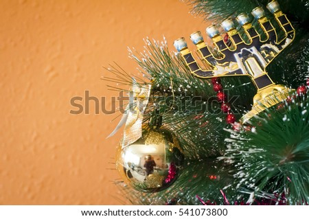 Jewish menorah on a Christmas (New Year) tree. In December 2016 Jewish holiday Hanukkah coincides with Christmas and New Year.