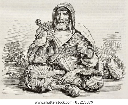 Jewish musician in Mogador, Morocco, old illustration. Created by Delacroix, published on Magasin Pittoresque, Paris, 1842