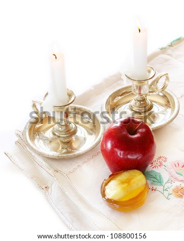 Jewish New Year - Rosh Hashanah ,  apple with honey and candles isolated - stock photo
