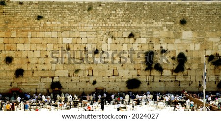 Jewish people praying at the most holy place for Jews