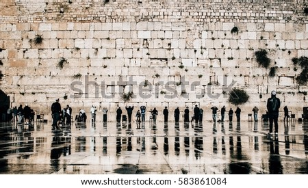 Jewish people praying at the western wall in the old town of Jerusalem, Israel.  ストックフォト ©