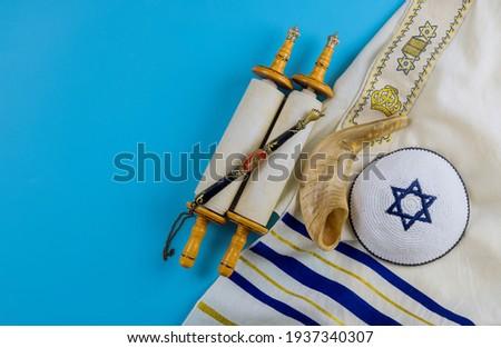 Jewish prayer book with torah scroll and shofar horn, prayer shawl tallit Orthodox religious symbols