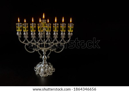 Jewish traditional lights holiday symbol Judaism Hanukkah menorah with are burning oil candles Stok fotoğraf ©