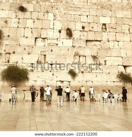 Jewish worshipers pray at the Wailing Wall. Vintage retro style