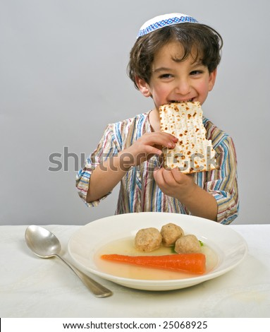 Jewish young boy having matzo ball soup