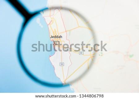 Jiddah, Saudi Arabia city visualization illustrative concept on display screen through magnifying glass #1344806798