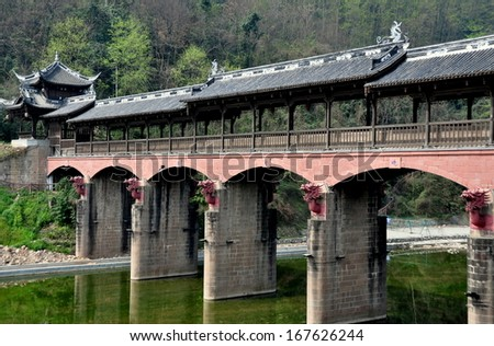 JIE ZI ANCIENT TOWN (SICHUAN), CHINA:   The handsome covered Dragon bridge, aptly named for its terra cotta dragon heads on each of its support towers