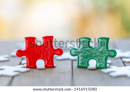 jigsaw puzzle and represent team support and help concept. business thinking.Concept business, teamwork and cooperation, strategy, cooperation. #1416915080