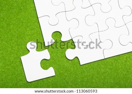 Jigsaw puzzle on green background
