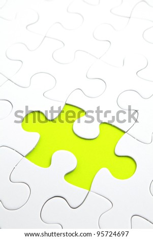 Jigsaw puzzle with green piece missed