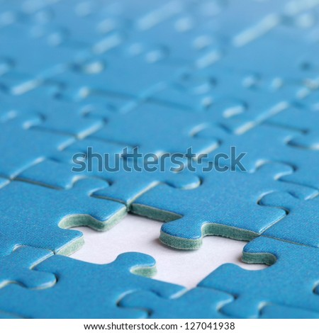 Jigsaw Puzzle with the missing piece, shallow depth of field