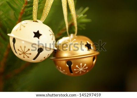 Jingle bells on Christmas tree with copy space. Selective focus, shallow DOF.