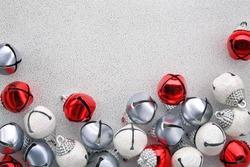 Jingle bells on silver background