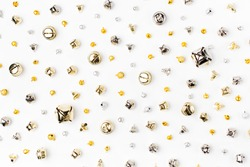 Jingle bells pattern. Christmas background in gold and silver colors. Flat lay,  top view