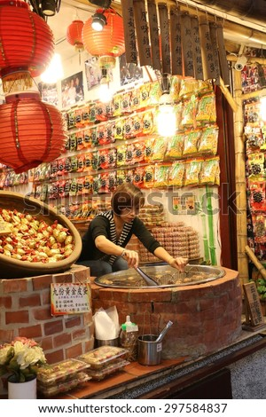JIUFEN, TAIWAN - APRIL 17, 2015: Food Stall at Jiufen Old Street, Taiwan on April 17, 2015. Jiufen is a popular destination for shopping as filmed in City of Sadness and Spirited Away.