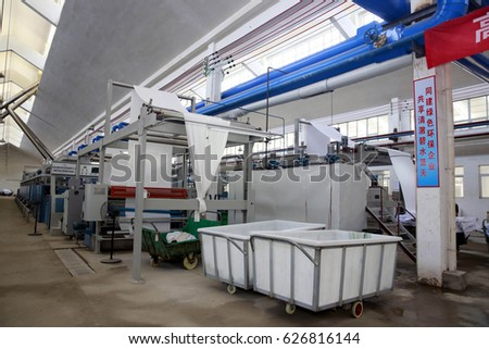 Jiujiang, China - July 30, 2014: Jiangxi Teng Ma textile printing and dyeing integration project began trial production, workers in the workshop for printing and dyeing operations. #626816144
