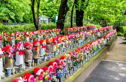 Jizo statues at the cemetery of Zojo-ji temple, Tokyo, Japan