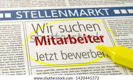Job ad in a newspaper - We are hiring - Wir suchen Mitarbeiter (German) Stockfoto ©