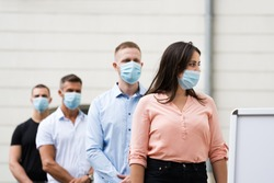 Job Center Line Of Jobless Unemployed Recruitment Seekers With Face Masks