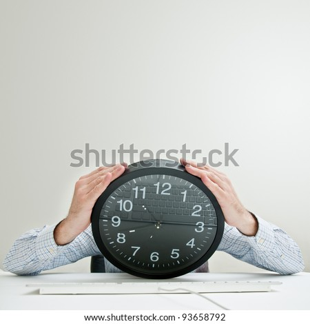 Job deadline. Businessman with clock head looking desperately down as the time passes by. Tight schedule, short terms, business stress conceptual image. - stock photo