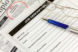 Job Description with Pen and Newspaper Ad