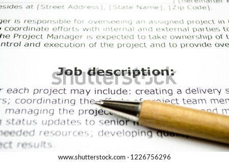 Job description with wooden pen