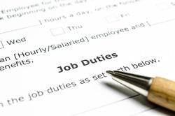 Job Duties contract with wooden pen