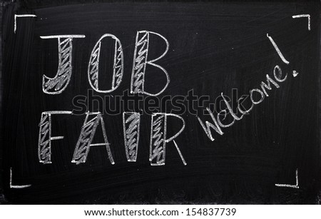 Job Fair welcome sign written on a used blackboard. Employers, recruitment agencies and job seekers use these recruitment fairs to hire people for the jobs available in their companies.