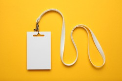 Job identity name tag on yellow background, badge and lanyard. Staff identity card.