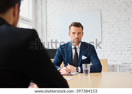 Job interview - businessman listen to candidate answers