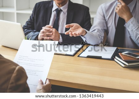 Job interview, Two selection committee manager asking questions to applicant about work history, colloquy dream,  Skill, expertise, experience and businessman listen to candidate answers. #1363419443