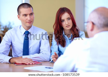 Job interview, two young colleagues from hr department and senior applicant