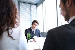 Job interview with the employer, businessman listen to candidate answers.