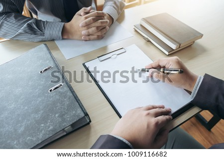 Job interview, Young attractive executives man asking questions to applicant about work history, colloquy dream,  Skill, expertise, experience and businessman listen to candidate answers.