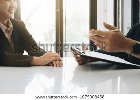 Job interview, Young executives man asking questions to applicant about work history, colloquy dream, Skill, expertise, experience and businesswoman listen to candidate answers. #1075008458