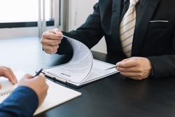 Job interviewer examining resume. To check the history and ability of those who apply for the job that meet the company needs or not.