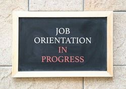 Job orientation in progress, words on blackboard. Business or onboarding concept.