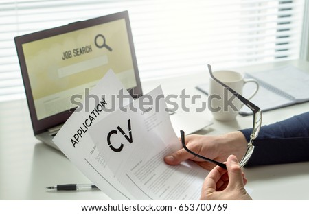 Job seeker in home office. Motivated applicant. Modern job hunting, seeking and employment. Man reading his cv or curriculum vitae and job application paper and trying to find work and get hired.