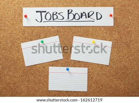 Jobs Board banner on a cork notice board with blank white note cards as a concept for job searching and employment opportunities.