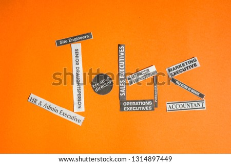 Jobs or careers concept: job titles or occupations cut off from newspaper to make up the word Jobs, on orange background #1314897449